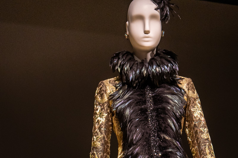Detail of Silk jacket embroidered with 12-karat gold spun thread and silver spun thread embellished with sequins, feathers and Swarovksi crystals