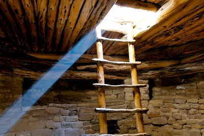 "Spruce Tree House, Mesa Verde National Park, Colorado.  When I climbed down into the kiva and saw this shaft of light, I knew I needed to shoot it, but I had no tripod!  So I did my best to balance the camera in one of the recessed areas on the kiva wall.  When there was still a little blurring in the image, it became ""Photoshop watercolor filter to the rescue!""   Really, the strength of this composition is in the lines and the color of the shaft of light, none of which is lost in giving it the a painted look.  This image was on display at Denver International Airport as a 24x36 canvas for a while, and was my first publicly displayed work."