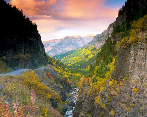 """A view of Canyon Creek and changing aspen trees at sunset, along the road from Ouray up into Yankee Boy Basin.  I left myself lots of time to set up this shot, arriving an hour or so before sunset and cooking dinner on the campstove.  It's nice to not be in a hurry, so I can remember to just """"be"""" and enjoy the place.  This photo was exhibited in the Denver Airport and at the Colorado State Capitol."""