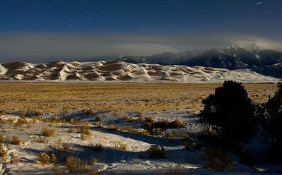Great Sand Dunes at night, December 2007.  It was probably -20F and dead calm when I shot this.  Good time to have the warm car nearby for the six minute exposure.  I've also shot at this exact spot at sunset in the fall, too.