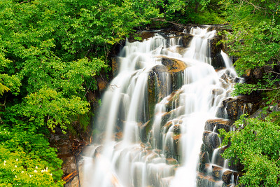 "Near Stevens Creek in Mount Rainier National Park.  While I was shooting, a couple of other photographers came by to join me.  Apparently, this is called ""Picture Frame Falls.""  Since it was getting dark this was a pretty long exposure, about 2 minutes I think."