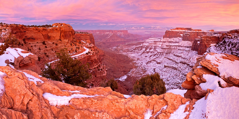 The Shafer Trail in Canyonlands National Park, on New Year's Day, 2009.  I've learned to appreciate days with high, thin clouds; sometimes they catch fire like this just after the sun goes down.  This is a tough spot to photograph in direct light at sunset, as the canyon tends to get lost in deep shadow.  Add the magical snow-covered north slopes of the winter season to the soft pink light and it made for a beautiful few minutes.