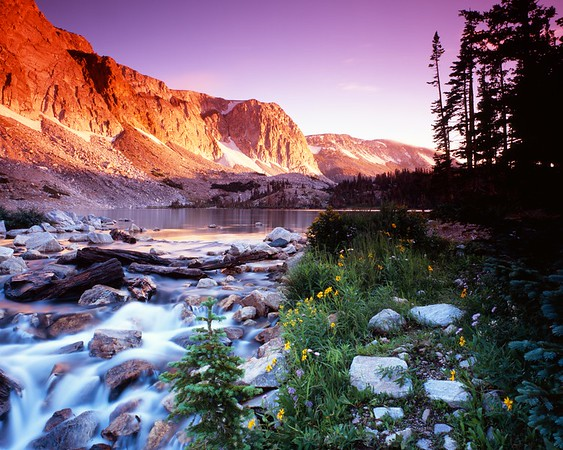 """""""Snowy Range Sunrise"""", shot on Fuji Velvia 100 4x5 film, at the outlet of Lake Marie in southern Wyoming.  This is the northern end of the Medicine Bow Range.  Great spot to visit in early August (this was August 10, 2008).  My wife and I went up to Centennial the night before and stayed at the Mountain View Hotel, so I could """"sleep in"""" until 4:30.  Awesome conditions, even little wisps of fog blowing east off the top of the mountains.  This photo has been exhibited in two national photography contests."""