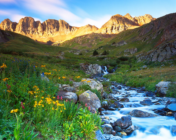 American Basin, near Lake City, Colorado, shot in late July 2010.  Rented a Jeep in town the night before and drove up early in the morning.  This is a very popular spot in the summertime, but I was the only one there at 5:15 AM.  You can definitely trade some sleep for early morning solitude.