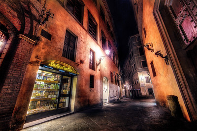 Yummy Nights in SienaSiena, Italy  I keep referring to strolling through Siena at night in food terms. It's because on a warm summer night, if just feels so delicious you could eat it up with a spoon!  ©Karen Hutton - Creative Commons (CC BY-NC 3.0)