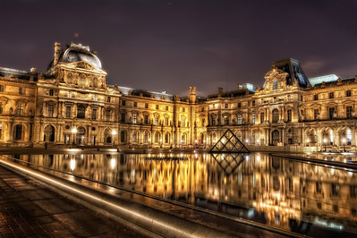 The Louvre.Paris.  Late at night. December. Butt-cold.  More fun than I dreamed possible.  It was a night that spanned snow, ice, 8 miles on foot, cognac and chocolate on the Champs Elysees at 2 a.m. and sights that defied both gravity and belief.   It was... pure magic.    ©Karen Hutton - Creative Commons (CC BY-NC 3.0)