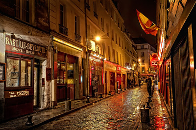 Rue de Lappe, Paris You could almost hear the music from the 1930's dance halls pouring out onto the street. Almost. This street was famous for them back in the day. Here in the Bastille neighborhood of Paris, Rue de Lappe is still quite the lively nightspot. With any number of bars, cafes, creperies, restaurants and clubs to choose from... you can keep going into the wee hours, whether you're eating, drinking... or shooting crazy HDR photographs!    ©Karen Hutton - Creative Commons (CC BY-NC 3.0)