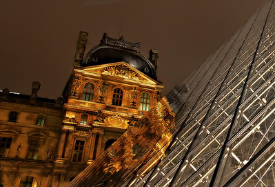Then and Now I love this photo. Obviously, taken at the Louvre. At night. Reflection on the pyramid thing going on. History and modern. Old and new. I love juxtapositions, don't you?    ©Karen Hutton - Creative Commons (CC BY-NC 3.0)