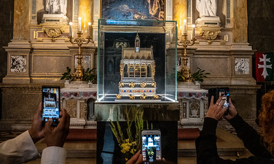 Tourists Take Photos Of A Religious Relic, The Right Hand Of St. Stephen