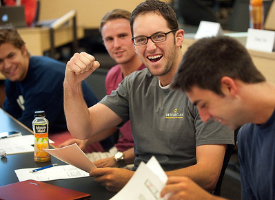 A student reacts as he finds out his grade in a ROSS University of Michigan class in Ann Arbor, MI.