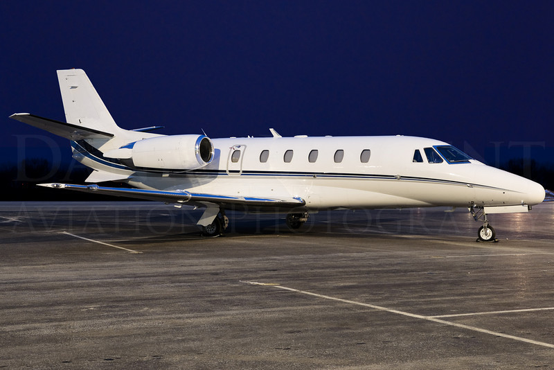 This Citation is photographed at night underneath sodium vapor lights and specially balanced to reveal proper color. Night photos can give a vastly different look than daytime or evening photos, and can reveal a different side of a jet.<br /> <br /> Registrations removed via post processing.