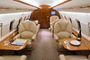 Interior of a Challenger. Challengers are bigger than most business jets and feature large, inviting cabins. Emphasizing that roominess and the features of a higher level cabin is key.