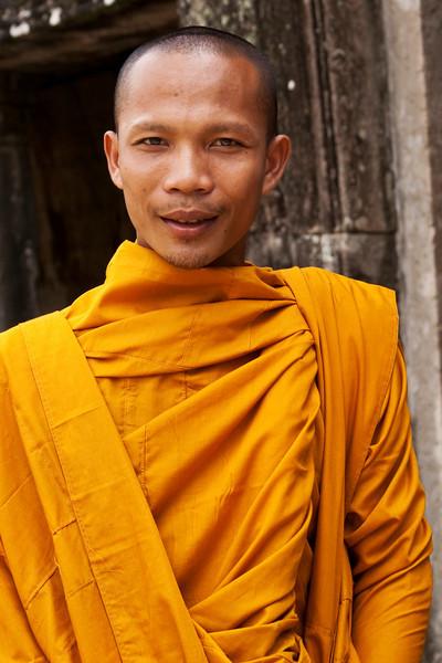 MONK SANG SUN. ANGKOR THOM BAYON. SIEM REAP. CAMBODIA. NORTH GATE.
