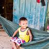 PHNOM PENH. LITTLE BOY IN A GARBAGE DUMP VILLAGE.