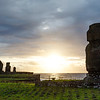 Sunset at Ahu Tahai, site with moai statues at Easter Island, Chile