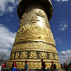 SHANGRI-LA. TURNING THE PRAYER WHEEL. YUNNAN.