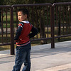 BEIJING. CHINESE BOY POSING IN FRONT OF THE TEMPLE OF HEAVEN.