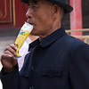 BEIJING. FORBIDDEN CITY. OLD CHINESE MAN DRINKING.
