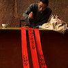 LESHAN. GIANT BUDDHA MUSEUM. OLD MAN IS WRITING. SICHUAN. CHINA.