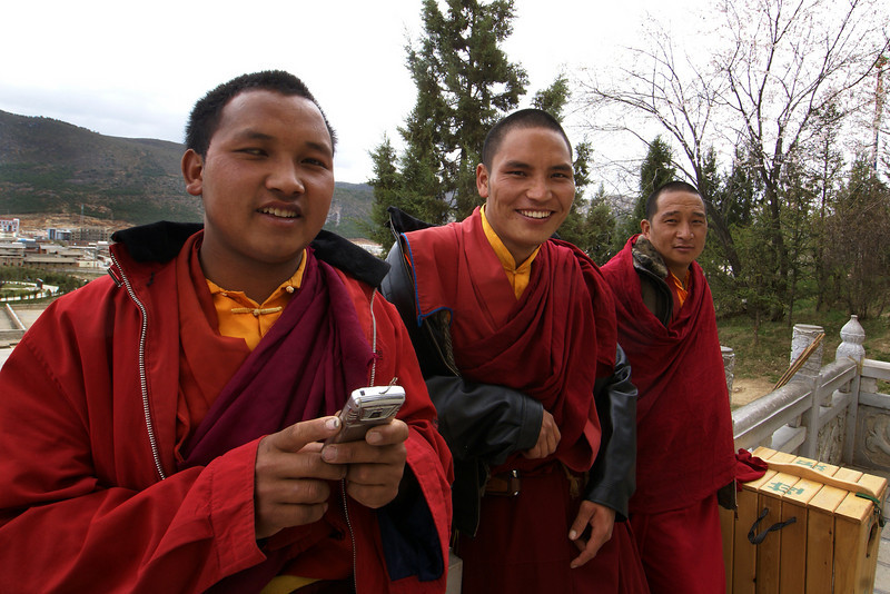 SHANGRI-LA. YUNNAN. THREE BUDDHIST MONKS AND ONE CAMERA.