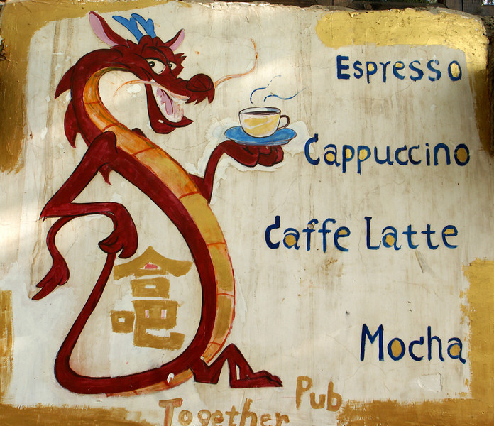 LIJIANG. SHUHE OLD TOWN. YUNNAN. OLD NAXI TOWN. SIGN OF THE TOGETHER CAFE PUB.