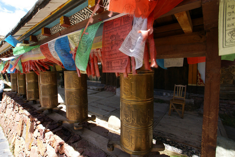 LIJIANG. SHUHE OLD TOWN. YUNNAN. PRAYER WHEELS IN THE OLD NAXI TOWN.