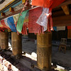LIJIANG. SHUHE OLD TOWN. YUNNAN. PRAYER WHEELS IN THE OLD NAXI TOWN.