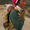YOUNG GIRL WITH BABY. SHANGRI-LA. YUNNAN. CHINA.