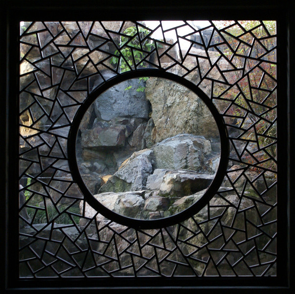 SUZHOU. HUMBLE ADMINISTRATOR'S GARDEN. WINDOW WITH A ROCKY VIEW. CHINA.