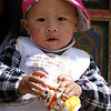SHANGRI-LA. A PORTRAIT OF A CHINESE BABY. YUNNAN. CHINA.