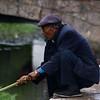 LIJIANG. SHUHE OLD TOWN. YUNNAN. OLD NAXI TOWN. OLD CHINESE MAN FISHING.