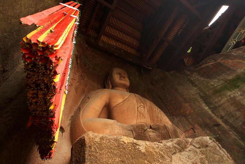 LESHAN. GIANT BUDDHA. BUDDHA STATUES ON THE WORLD HERIGE SITE. SICHUAN. CHINA.