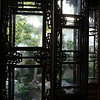 SUZHOU. HUMBLE ADMINISTRATOR'S GARDEN. VIEW OF THE GARDEN THROUGH OLD WINDOWS. CHINA.
