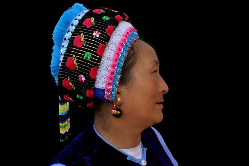 LIJIANG. BAI LADY WITH TYPICAL BAI HEAD DRESS. YUNNAN. CHINA.