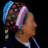 LIJIANG. BAI LADY WITH TYPICAL BAI HEAD DRESS. YUNNAN. CHINA.