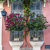 Facade of a colorful colonial house in the old center of Cartagena de Indias, Colombia, South America