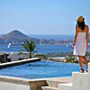 Cabo San Lucas, Mexico --- Young Woman On Poolside Terrace, Cabo San Lucas, Mexico --- Image by © Colleen Cahill/*/Design Pics/Corbis