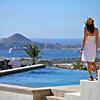Cabo San Lucas, Mexico --- Young Woman On Poolside Terrace, Cabo San Lucas, Mexico --- Image by © Colleen Cahill/*/Design Pics/Corbis