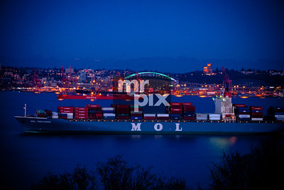Port of Seattle. Ships waiting to be unloaded. Seattle city lights and the waterfront, Elliott Bay, Seattle, WA. Architectural and Industrial Photography by Michael Moore