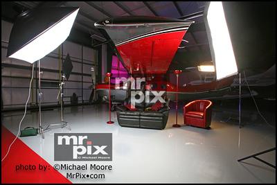 Airplane hangar lighting setup for fashion shoot