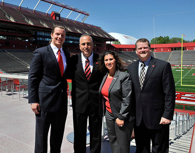 Rutgers football head coach Kyle Flood (second left to right) with student athlete and scholarship donors at the Brown's Family Recruiting Pavilion terrace at the High Point Solutions Stadium in Piscataway, New Jersey.