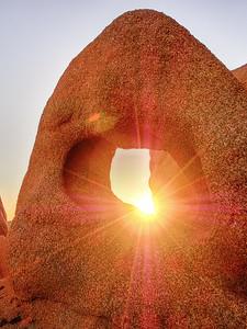 Sunrise through a hidden arch Joshua Tree National Park
