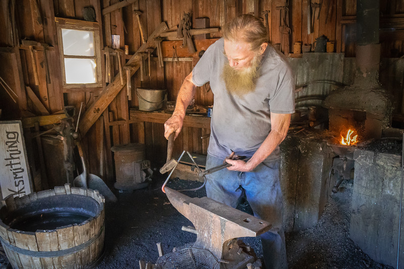 Klaus, the blacksmith, making a triangle at Calico Ghost Town