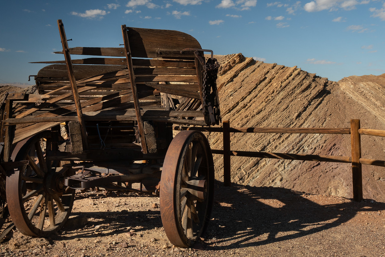Old wagon in front of the rugged mountains at Calico