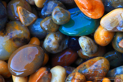 """""""Colorful Pebbles"""" Location: Pebble Beach, San Mateo, California. [GPS/Map]  Pebble Beach is fascinating for it's interesting rock formation, but people often fail to notice the little colorful pebbles after which the beach is aptly named.  I used a macro lens to zoom onto these little gems. It's too bad you are not allowed to bring these home.  Tech Info: Lens: Canon EF 100mm f/2.8 L IS Macro  Camera: Canon 5D Mk II Exposure: 8sec at f/29 and ISO 320 Filters: B+W Circular Polarizer to extentuate the colors and minimize water reflection  The coastline of the Bean Hollow State Beach has one of the most unique rock formations. It is always a joy to visit this location and photograph it during sunset. There are no long sandy beaches to be found here but only the rugged stone formations eroded in strange and sometimes beautiful formations called """"tafoni"""". I have been visiting here for many years and though I am somewhat satisfied with the images I have captured, I feel that the beauty of this place is best seen in person.  These are twin beaches, Bean Hollow State Beach and the Pebble Beach.  Both beaches are amazing with their rock formations, colorful pebbles, tide pools, tafoni and of course the open views of the pacific ocean."""