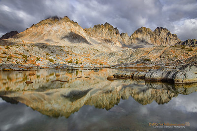 """""""North Palisades"""" Location: Dusy Basin, Kings Canyon Backcountry, California.  These are some of the highest mountains in the Seirra Nevada range, next only to majestic Mt. Whitney. I captured this image while camping at scenic Dusy Basin. The backcountry hike to Dusy Basin is one of the most scenic hikes to do in eastern sierra mountains. The dusy, as a final destination, offers fantastic views of the sierra mountains and pristine quietness that is hard to find anywhere else.  Making this particular image was an interesting adventure. We had planned a two day hike and it was raining on and off all the time. When we reached here it was raining again and I thought I would miss any opportunity to photograph here. Then clouds opened up giving me a brief window of about an hour when I could get this image. I was happy that the clouds were still in the sky while opening up just a bit to allow sunlight to shine on the peaks.  Tech Info: Lens: Canon EF 17-40mm f/4L @ 26mm Camera: Canon EOS 5D Mk II Exposure: 5sec at f/16 and ISO 50 Filters: LEE ND Grads 0.9 soft edge along with Singh-Ray Vari ND solid grad set at about 8 sopts to allow long exposure  One has to really visit eastern sierra landscapes to truly appreciate its beauty. I don't think any photograph can do the justice of what it feels to hike on barren landscapes, camp besides some of the most scenic lakes and feel out of breath at high altitudes. Over the years I have had a few chances to hike on eastern sierra mountains including Mt. Whitney, but only recently I began to photograph it. So here are few images from one of the most unique places on the Sierra-Nevada mountain range."""