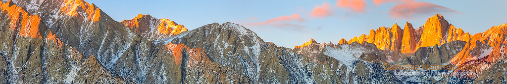 """Mt Whitney at Sunrise"" <br>Location: Alabama Hills, Lone Pine, California.  <p>Mt. Whitney is the highest point in lower 48 continental US at about 14,500 ft. The hike up to the top is one of the most rewarding things to do. I had a pleasure to do that a few years ago. We hiked up to 12000 ft the day before and camped overnight at a spot called Trailcamp. The next day I saw the fascinating orange glow on the peak at sunrise and since then wanted to photograph it. The opportunity came recently when I visited the town of Lone Pine and was able to photograph this magestic mountain at sunrise.  </p><p>This is a panorama image made from three horizontal shots and later stitched in photoshop.  </p><p>Tech Info: <br>Lens: Canon EF 70-200 f/4L IS @ 200mm <br>Camera: Canon EOS 5D Mk II <br>Exposure: 1 sec each at f/13 and ISO 50 <br>Filters: No filters.  <br><br>One has to really visit eastern sierra landscapes to truly appreciate its beauty. I don't think any photograph can do the justice of what it feels to hike on barren landscapes, camp besides some of the most scenic lakes and feel out of breath at high altitudes. Over the years I have had a few chances to hike on eastern sierra mountains including Mt. Whitney, but only recently I began to photograph it. So here are few images from one of the most unique places on the Sierra-Nevada mountain range.</p>"