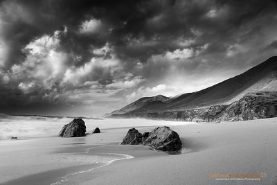 """Doomsday Forecast"" Location: Garrapata State Park, Monterey-Carmel Area, California.  It is sometimes fun to venture out on a stormy day. As the clouds were just getting ready for the downpour I decided to make this final shot before heading back to shelter.  Tech Info and Tip: Lens: Canon EF 17-40mm f/4L @28mm Camera: Canon 5D Mk II Exposure: 0.6sec at f/11 and ISO 50 Filters: SinghRay 3 Stop ND grad hard edge Garrapata state park is one of the most photographed locations on the California coast. People are drawn to this spot due to the rugged coastline and its famous sea stacks. Just south of Monterey, California it is one of the best places to see waves crashing against the rugged coastline."