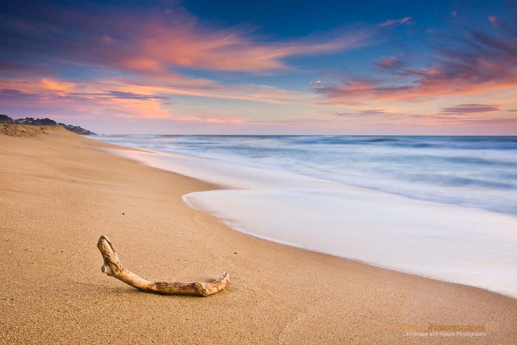 """Sunset Glow"", <br>Location: Montara Beach, California.  <p><p>Montara beach just north of Half Moon Bay is quite featureless but an interesting place to wind down at the end of the day. As the sun was setting over pacific the beauty of this place was even more appealing.  <p>Tech Info Tip: <br>Lens: Canon 10-22mm f/3.5-4.5 @18mm <br>Camera: Canon 30D <br>Exposure: 2.5sec at f/16 and ISO 100 <br>Filters: SinghRay 2 stop ND grad hard edge"