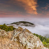 """Lichen Rock"" Location: Mt. Tamalpais, Mill Valley, California.  One of the most spectacular displays of nature in the San Francisco bay area is the fog rolling into the bay, and viewing it from the top of Mt. Tamalpais is like going to another world above the clouds. Also seen in the image are lichen covered rock and the golden grass that are so characteristic of the California landscape.  Tech Info and Tip: Lens: Canon 17-40mm f/4L @29mm Camera: Canon 5D Mk II Exposure: 2sec at f/11 and ISO 50 Filters: SinghRay 2 stop hard edge ND grad  I learnt recently that lichens were one of the first species to evolve on the planet giving rise to more complex plants. This place gives a sense of perspective where these lichens can be seen together with the giant redwoods at the foothills. <br><br>San Francisco is a busy metropolitan area but just a few miles to the north exists a place so quiet and unique that it is such a perfect escape from the chaos of the city life. Mt. Tam, as it is locally know, is a perfect vantage point to watch the summer fog rolling into the bay or just enjoy the hike on its undulating hills and redwood forests."